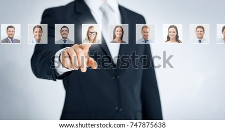human resources, career management, recruitment and success concept - man in suit pointing to one of many business people portraits