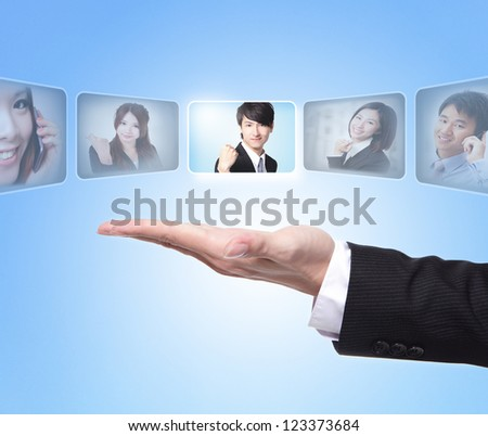 Human Resources concept: business man hand choosing perfect employees options by touch button screen - stock photo