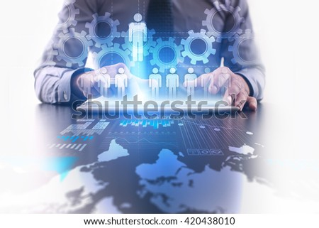 Human Resources concept. Businessman using futuristic tablet computer, pressing people icon on the touchscreen.  Reruitment, HR and teambuilding. - stock photo