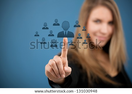 Human resources, CRM and social networking concept - female officer choose person (employee) represented by icon. - stock photo