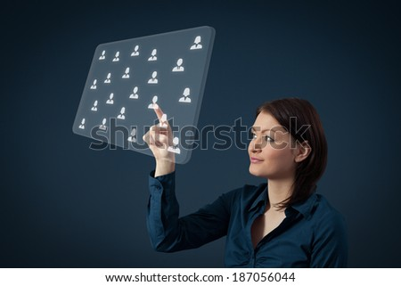 Human resources, CRM and social networking concept - female officer choose person (employee) displayed on futuristic virtual screen. - stock photo