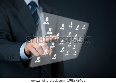 Human resources, CRM and social networking concept - officer choose person (employee) displayed on futuristic virtual screen. - stock photo