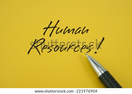 Human Resources! note with pen on yellow background