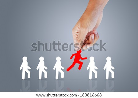 Human resources officer choose employee standing out of the crowd. Leadership concept - stock photo