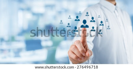 Human resources officer choose employee standing out of the crowd. Select team leader or assessment center concept. Wide composition, office in background.  - stock photo