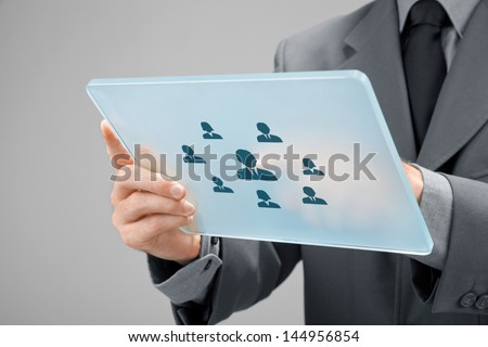 Human resources, personal audit, CRM, and assessment center concept - recruiter select employee (or team leader) represented by icon on futuristic tablet. - stock photo