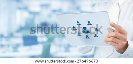 Human resources, personal audit, CRM, and assessment center concept - recruiter select employee (or team leader) represented by icon on futuristic tablet. Wide composition, office in background.  - stock photo