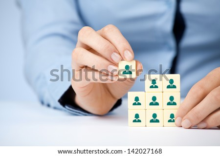 Human resources, social networking and assessment center concept - recruiter complete team by one person (employee) represented by icon.  - stock photo
