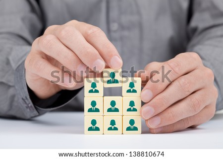 Human resources, social networking and sales force team concept - recruiter complete team by one person (employee) represented by icon. - stock photo