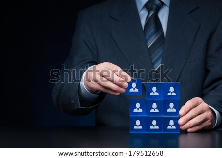 Human resources, social networking, assessment center concept, personal audit or CRM concept - recruiter complete team by one person. Employees are represented by blue glass cubes with icons. - stock photo