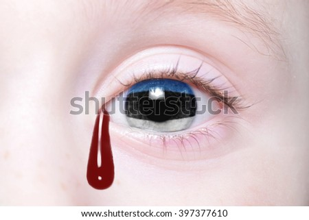 human's eye with national flag of estonia with bloody tears. concept - stock photo