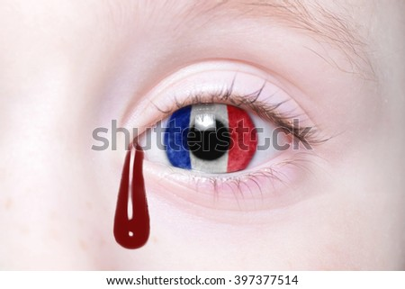 human's eye with national flag of france with bloody tears. concept - stock photo