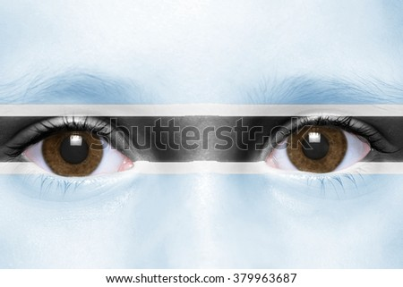 human's face with botswana flag