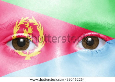 human's face with eritrean flag  - stock photo
