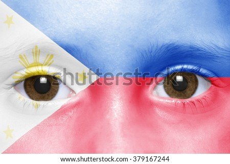 human's face with philippines flag  - stock photo
