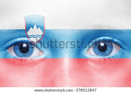human's face with slovenian flag
