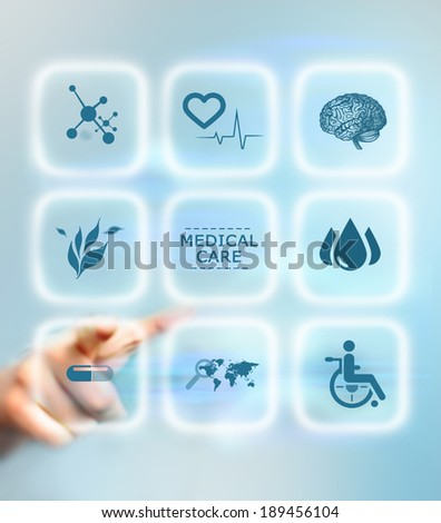 Human's hand pushing the medical button. Medical care service concept - stock photo