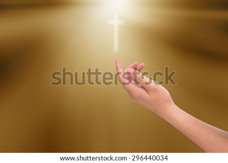 human's hands praying and showing cross on blurred sepia tone background : hand open receiving power from god. religion concept. - stock photo