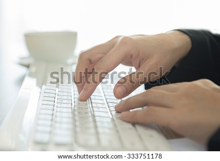 human's hands typing on computer keyboard. selective focus. - stock photo