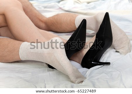 Human sex - men and women couple naked foot on bed