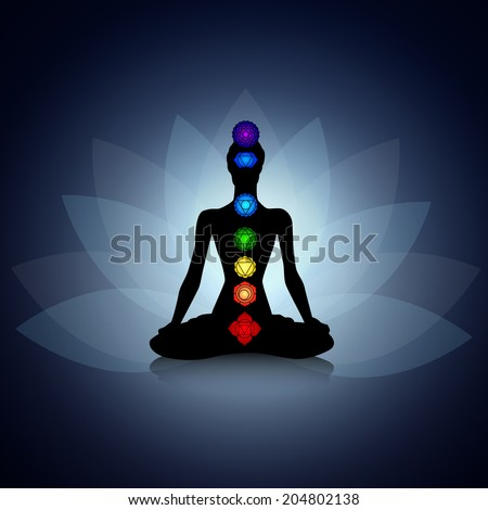 Human silhouette in yoga pose with chakras - stock photo