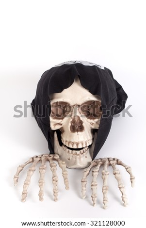 Human Skull and Human Hand with devil black cap isolated on white