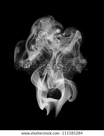 Human skull appearing in the smoke