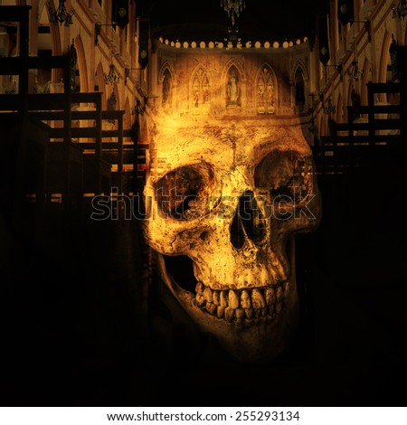 Human skull in black hood as image of death - stock photo