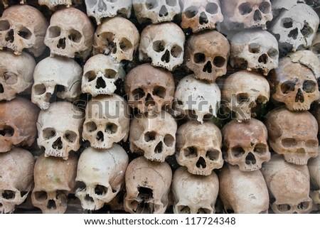 Human skull on a wat thmei ,siem reap ,Cambodia - stock photo
