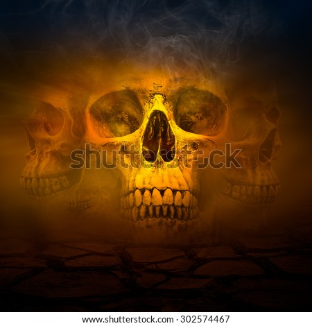 Human skull with smoke and cracked soil in concept of natural conservation and save the world