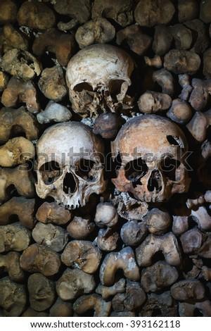 Human skulls inside Paris Catacomb - stock photo
