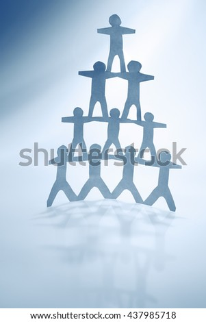 Human team pyramid holding hands