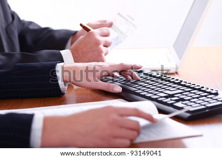 Human touching keyboard buttons in working environment
