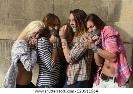 Human Trafficking: Group of young women kidnapped by gang - stock photo