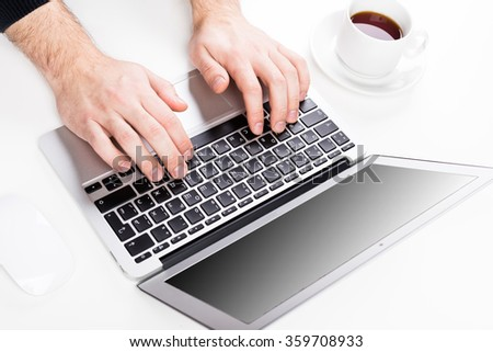 Human typing on keyboard