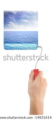 human with roller paint sky and sea - stock photo
