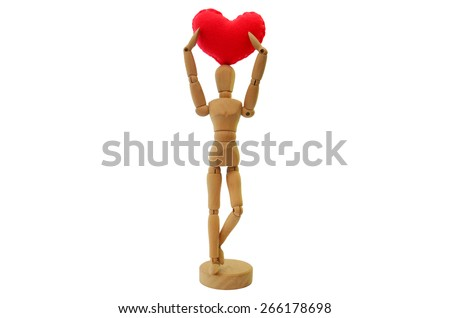 Human wooden figure with Handmade Heart model made from velvet - stock photo