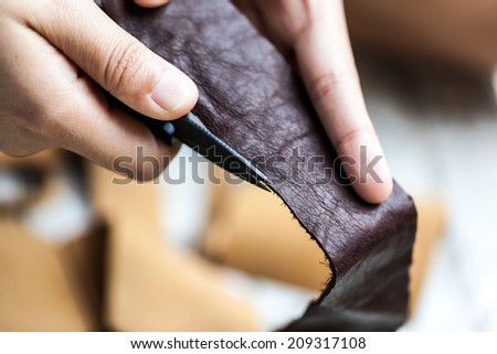 human working on Cut leather - stock photo