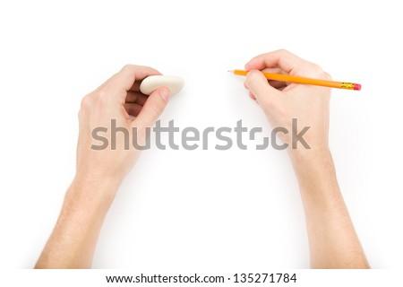 Human writing and erasing something. Isolated on white with shadows - stock photo