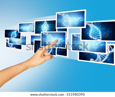 Humans finger pointing blue holographic pictures on abstract background