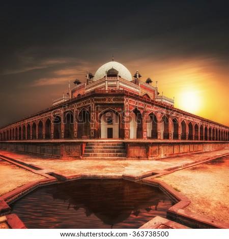Humayun`s Tomb at sunset. Amazing Mughal architecture of 1565-72 A.D. India, Delhi, Uttar Pradesh - stock photo