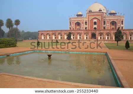 Humayun's Tomb with water pool in front of it, Delhi, India. It was the first garden-tomb on the Indian subcontinent. - stock photo