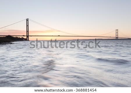 Humber Bridge at sunrise (Hull, UK) - stock photo
