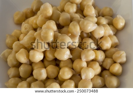 Hummus beans on a white plate