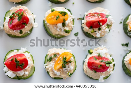 hummus bites with cucumber and tomatoes  - stock photo