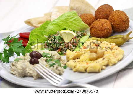 hummus, falafel, baba ghanoush, tabbouleh and pita, middle eastern cuisine - stock photo