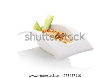 Hummus in white bowl isolate on white background. Minimal contemporary style. Culinary eastern cuisine. - stock photo