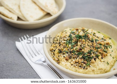 Hummus with pita bread - stock photo