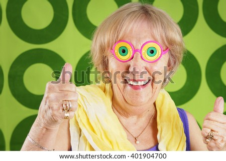 Humorous cool grandmother with crazy glasses