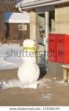 Humorous image of a snowman at the post office. - stock photo